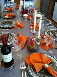 A gray tablecloth and dark china patterns make a holiday table contemporary and cool.</p> <p>Photo courtesy Caskata.