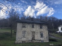 An abandoned house sits along the long-defunct Pittsburgh and Lake Erie Railroad line.