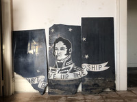 "ERIE, Pennsylvania — Shattered remnants of Commodore Oliver Hazard Perry's infamous motto, ""Don't Give Up the Ship,"" at the top of the stairs of a 100-plus-year-old building under reconstruction."