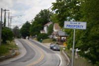 The sign for the village of Prosperity sits along state Route 18. Photo credit Justin Merriman.
