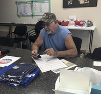 Ken Miller fills out the state election form to change his voter registration from Democrat to Republican. Photo credit Salena Zito.